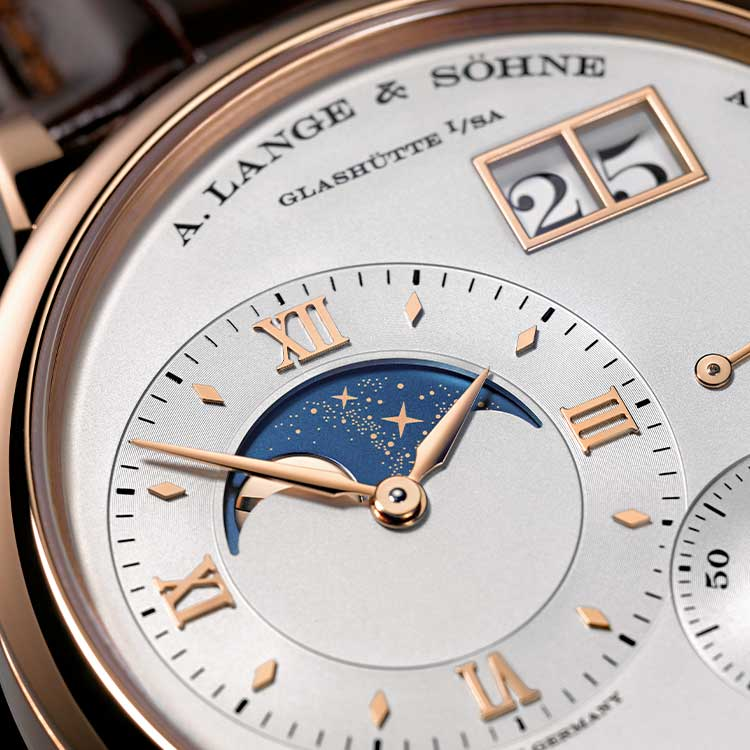 The off-centred dial fake watch has moon phase.